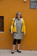 yellow raincoat yellow wall goofy grin