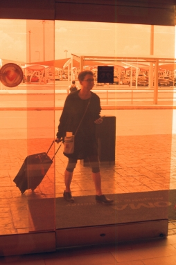 We had a five hour layover in Monterrey, where the airport doors are this astounding shade of orange. This was the last of the color film from the Praktica and I just love this so much.